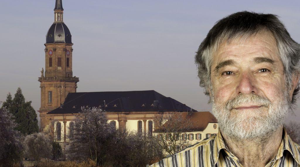 Foto-Collage: rechts im Vordergrund Mann mit hellgrauem Vollbart und dunkelgrauen Haaren, im Hintergrund Katholische Kirche Schuttern